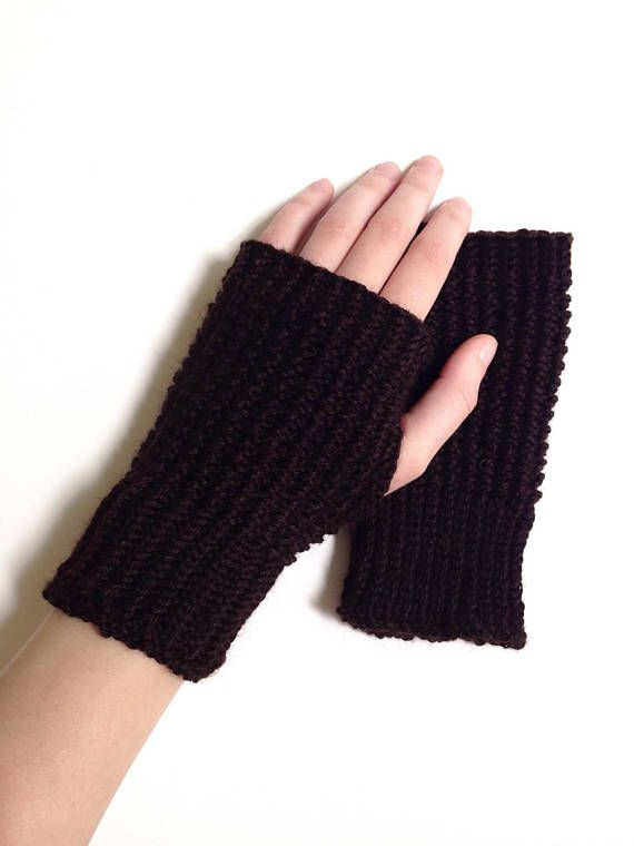 Warm gloves for winter in a simple textured design. Fingerless .