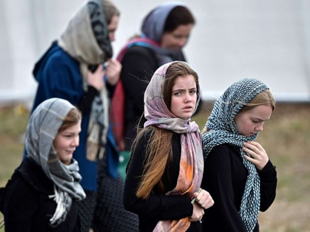 New Zealanders wear headscarves in display of solidarity after .