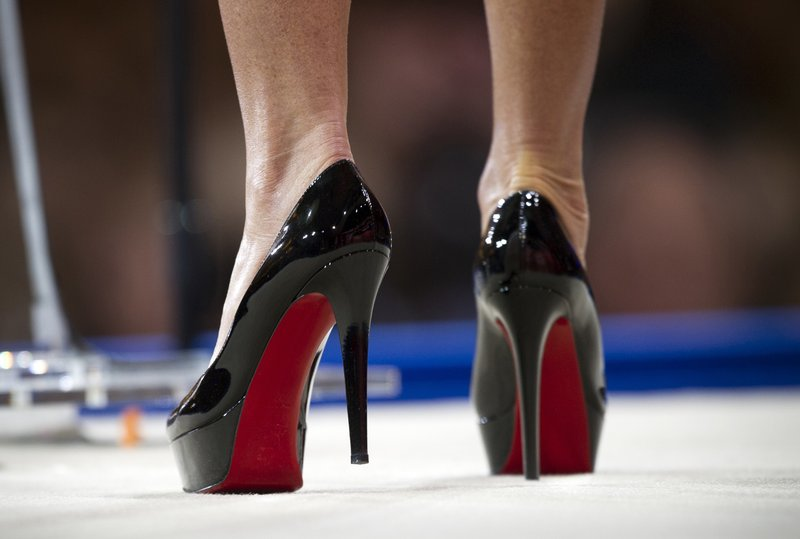 Designer Louboutin wins case on red soled high-hee