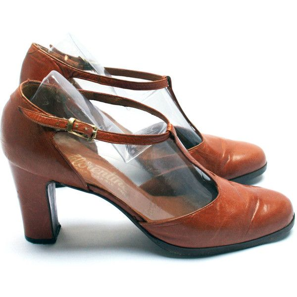 T-bar leather pumps . Women heel shoes . Tawny brown color .