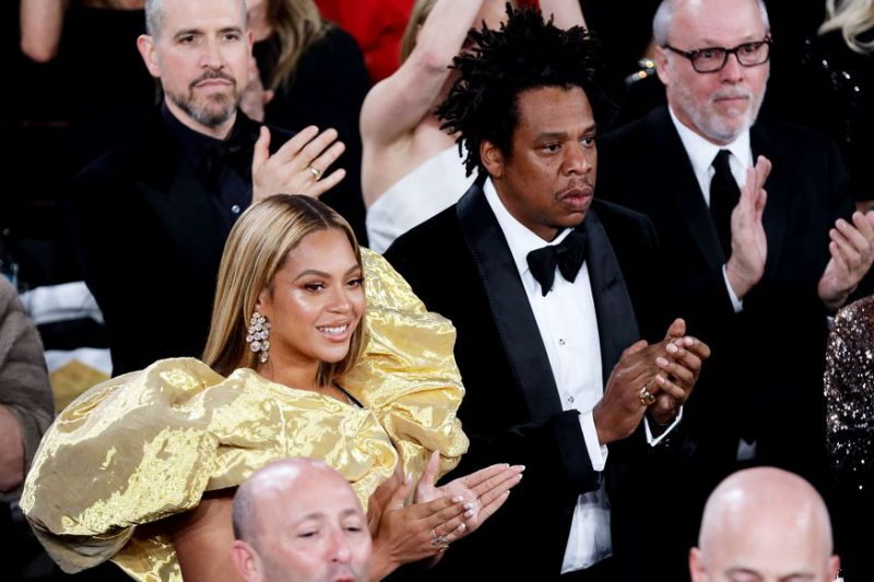 Beyoncé, JAY-Z and Her Jaw-Dropping Dress Sneak Into the Golden .