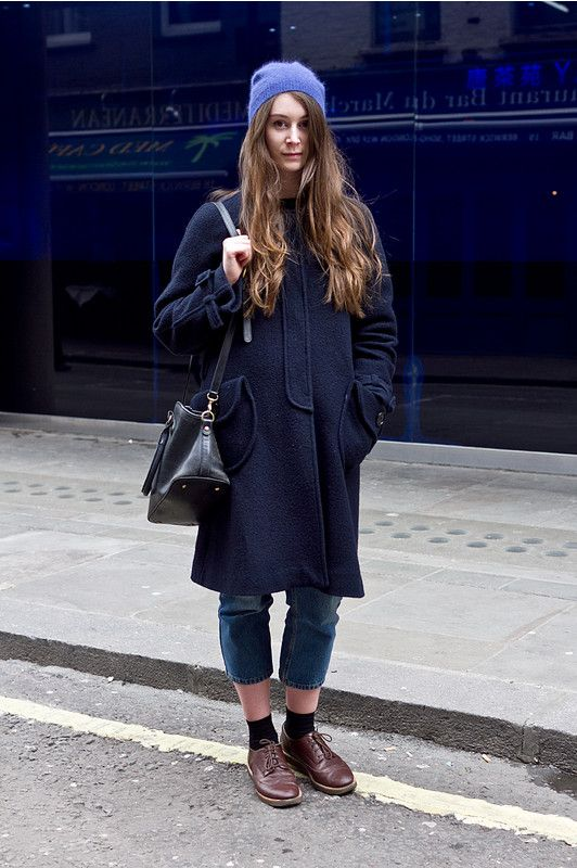 blue beanie, navy blue coat, cropped jeans, black socks, brown .