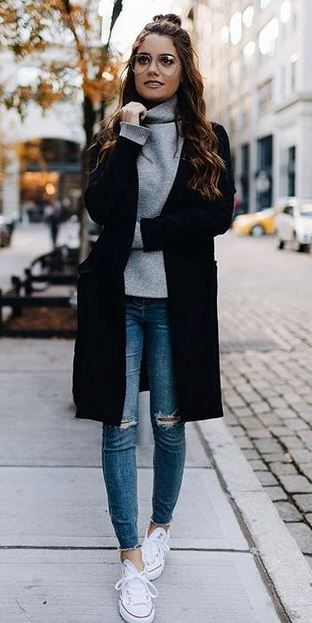 trendy outfit idea : black coat + sweater + rips + sneakers .